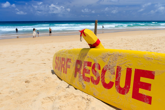 Yellow surf rescue board by the sea beach.