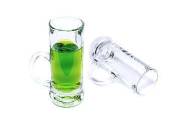 Glass with green absinthe