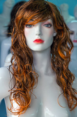 naked woman long hairs red copper colors mannequin