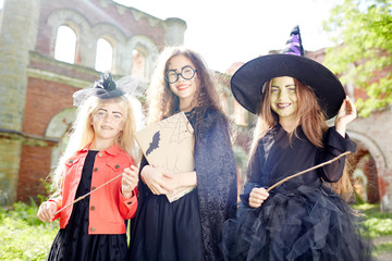Happy halloween witches having party on sunny october day