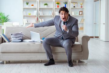 Sad businessman singing in office