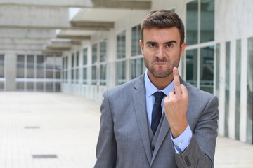 Insulting businessman throwing the middle finger