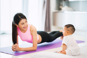 Asian mother fit and play Yoga for lose weight