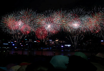 Fireworks explode over Victoria Harbour in Hong Kong