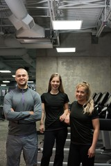Portrait of smiling friends standing at gym