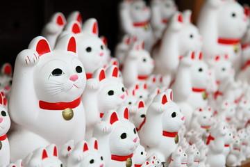 "Tons of small dolls ""the beckoning cat"" known as maneki neko at Gotokuji in Tokyo, JAPAN."