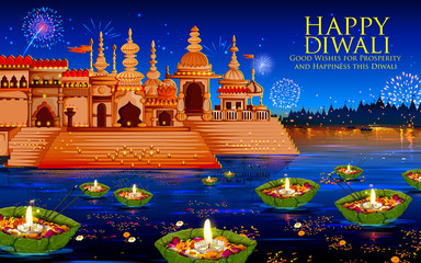 Floating diya in river on Happy Diwali Holiday background for light festival of India