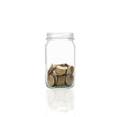 Coins in a jar, concept of cash accumulation for emergencies.