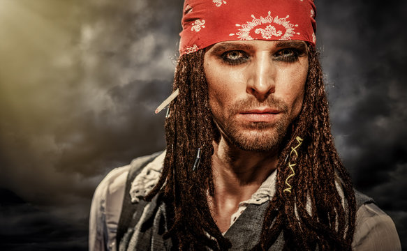 Portrait of a young man in a pirate costume.