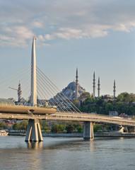 Day shot of Golden Horn Metro Bridge overlapping Suleymaniye Mosque, Istanbul, Turkey