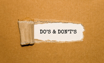 The text DOS AND DONTS appearing behind torn brown paper