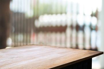 empty wooden desk over blurred interior decoration background