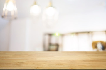blank wooden table with blurred montage coffee shop cafe background
