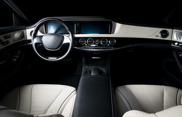 Modern luxury car interior, white and black leather dashboard