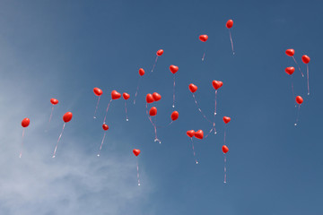 red balloons flying to the sky