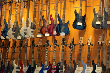 showcase of a music store with guitars