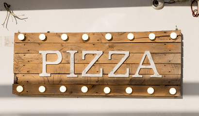 Rustic wooden pizza sign