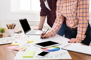 Unrecognizable designers working on project