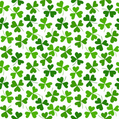 Seamless pattern with green clover on a white background