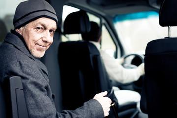 Senior Man Sitting In Paratransit Van