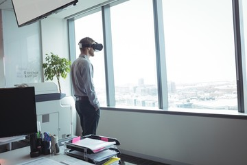 Businessman using virtual reality glasses at office