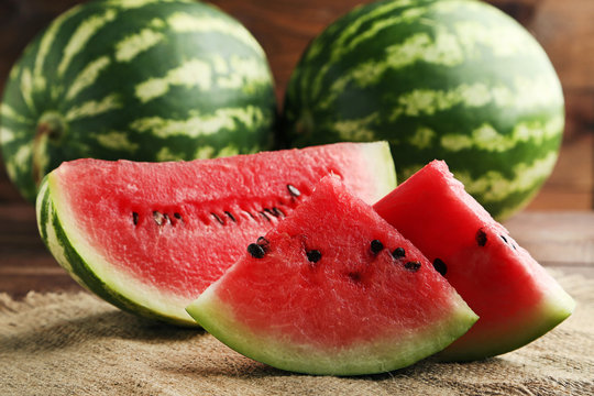 Slices of watermelons on wooden table