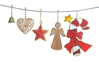 Hanging vintage Christmas decorations isolated on white background