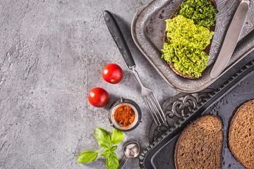 Pesto toasts on vintage tray top view with copy space