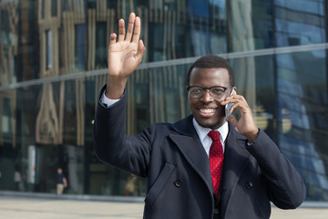 African american businessman greet and say hello to colleague in city outdoor.African american businessman greet and say hello to colleague in city outdoor.