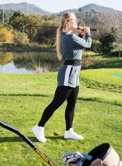 Female golfer at golf course