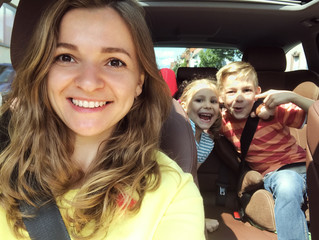 Family selfie photo in car on summer vacation