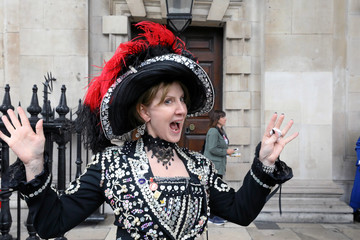 A woman wears an outfit decorated with buttons during the Pearly Kings and Queens Harvest Festival at the St Martin-in-the-Fields church at the Trafalgar Square in London