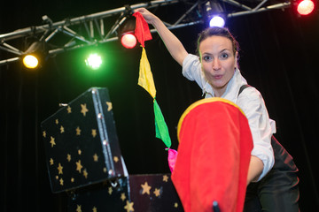 magician woman performing on stage