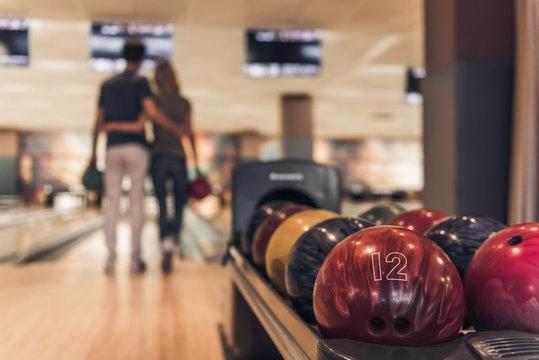 Couple playing bowling