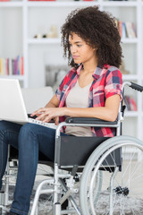 young girl on wheelchair surfing web