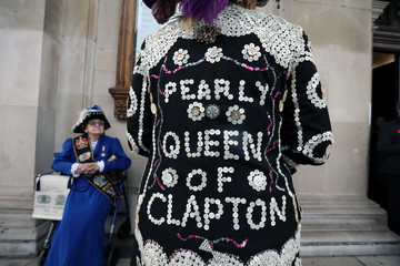 A woman in an outfit decorated with buttons is seen during the Pearly Kings and Queens Harvest Festival at the  St Martin-in-the-Fields church at the Trafalgar Square in London