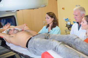 Man having scan of upper body