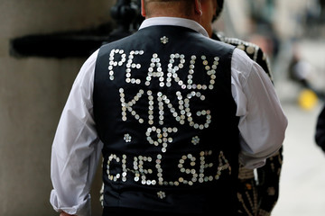 A Man wears a jacket decorated with buttons during the Pearly Kings and Queens Harvest Festival at the St Martin-in-the-Fields church at the Trafalgar Square in London