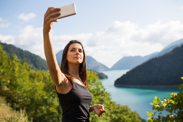 Young woman taking pictures on the phone