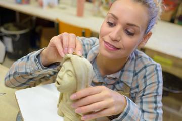 sculptor making a  figurine