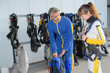 Two people preparing for parachute jump