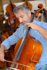 Mature man playing cello