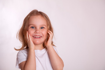 cute little girl smiling close-up in white t-shirt