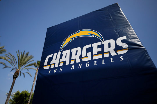 A sign with the Los Angeles Chargers logo is seen at the front of the StubHub Center where the Los Angeles Chargers are playing the Philadelphia Eagles in an NFL football game in Carson