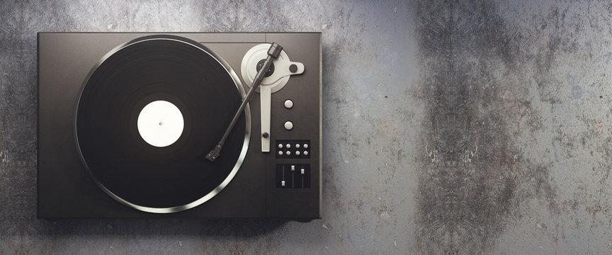 Vinyl record player on concrete background