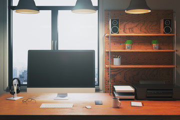Creative desk with empty computer