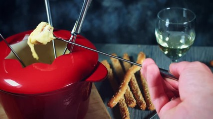 0 19 4k Dipping Bread In Mixed Cheese Fondue
