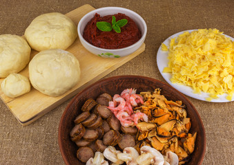 shrimp, mussels, mushrooms, salami . background ingredients for pizza.