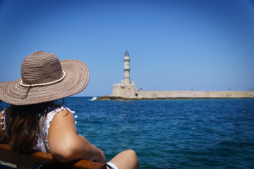 woman in front of the lighthouse from chania