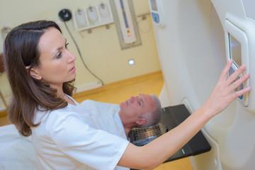MRI technologist operating the machine
